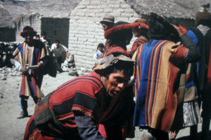 Villagers in Coroma, Bolivia dance in their sacred textiles. The textiles were systematically stolen by Western dealers and imported into the US and Canada. The people of Coroma felt their ancestors had been kidnapped