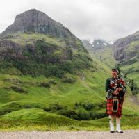 scottish_bagpiper_at_glen_coe_scotland_-_diliff