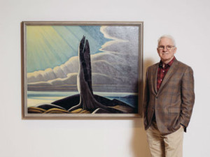 Martin as curator at his Harris exhibition.