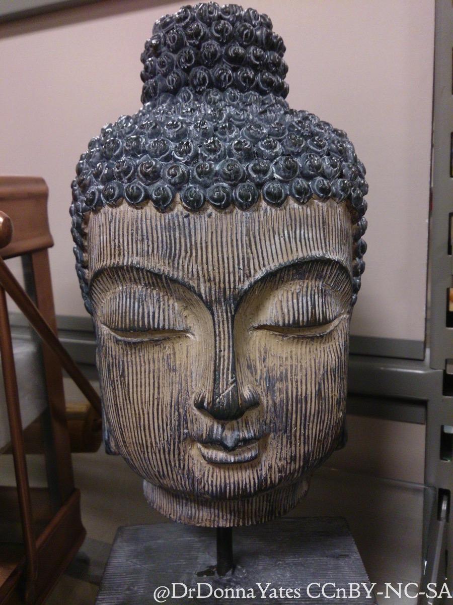Buddha Head Decor Illicit Antiquities Chic Faux Decapitated Buddha Heads As Decor